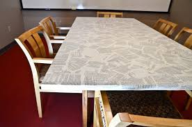 how to cover a table to cover an old table in book pages