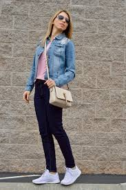 white nike sneakers and denim jacket current trend