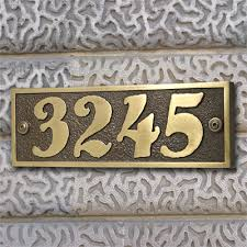 calypso home numbers in brass patina finish for the outside of