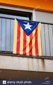 catalan independence estelada flag on a house balcony barcelona
