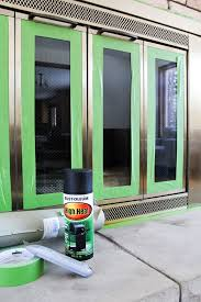 How To Spray Paint Doors - how to spray paint a brass fireplace bright green door