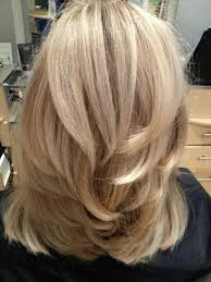 shoulder length hair with layers at bottom i cut it to a medium length put short to medium layers throughout