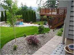 Landscaping Ideas For A Sloped Backyard by Us Small Sloped Backyard Patio Ideas Backyard Landscaping Ideas