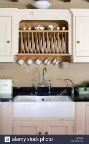 kitchen cabinets above sink fitted plate rack in fitted cupboard above white