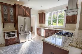 when updating old kitchen cabinets should you reface or replace