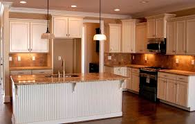 simple cream colored glazed kitchen cabinets on small home remodel
