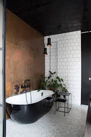 White Bathrooms by Black And White Bathroom With Copper Wall Plants Black