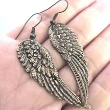 wing earrings bronze angel wing earrings by gaamaa notonthehighstreet