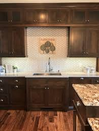 white kitchen cabinets with hexagon backsplash trends from the tour herringbone hexagons and terracotta