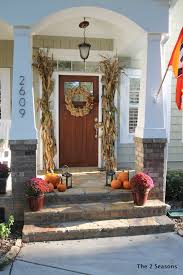 fall on the porch is easy to achieve with plants pillows u0026 a wreath
