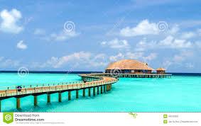 view of water bungalow in irufushi island maldives stock photo