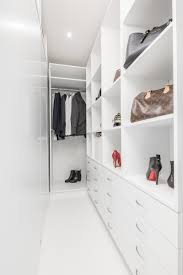 Furniture For Walk In Closet by Small Apartment With Unique Interior Design Covered In Glossy White