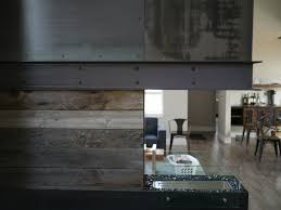 fireplace of rolled steel with c channel mantle with barn wood