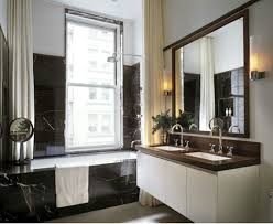large black wood mirror and white floating vanity for masculine
