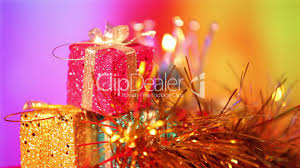 christmas gift and candle on defocused lights background royalty