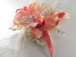 coral boutonniere coral and ivory pearl beaded orchid wrist corsage and