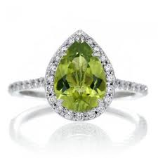 peridot engagement ring peridot engagement ring 10x7 pear halo band