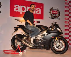 abraham owns an black aprilia rsv4