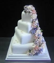 square wedding cakes square wedding cakes with cascading flowers camo wedding reviews