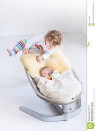 Newborn Swing Chair Toddler Climbing On Swing With Her Broter Stock Photo Image