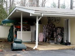 attached carport turning your carport into a garage adds value best garage door