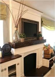 Bookshelf Around Fireplace Best 25 Tv Above Mantle Ideas On Pinterest A Tv Tv Above