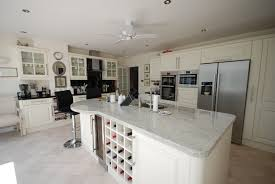 kilberry ivory painted kitchen with colonial white black granite