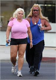 dog the bounty hunter and wife beth chapman getting a tan at sunset
