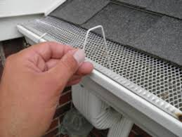 how to hang christmas lights on gutters christmas light hangers for gutters with mesh or perforated gutter