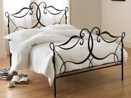 black iron carving bed with headboard and footboard also four legs