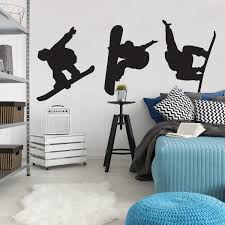 sports wall decals urban walls 3 black snowboard wall decals placed on a light blue wall above a wooden desk and