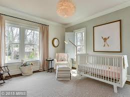 kids bedroom with hardwood floors crown molding zillow digs transitional kids bedroom with chandelier giada striped sheer drapery panel oeuf sparrow crib