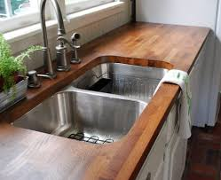 kitchen butcher block countertop with undermount sink and 4 hole