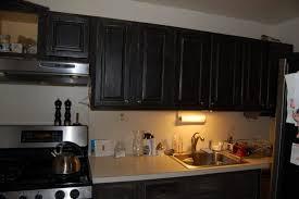 kitchen elegant black kitchen cabinet with mosaic backsplash and