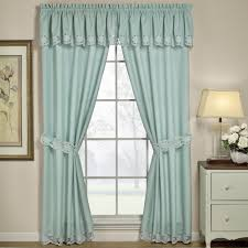 light blue woven curtain on silver polished iron rod combination