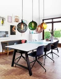 colorful orbs above the dining table breathe life into the curated