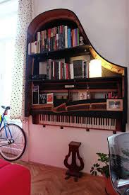 unique wall mounted bookshelves made by piano floating in the wall