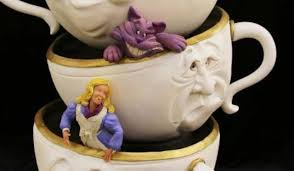 awesome alice in wonderland wedding cake between the pages