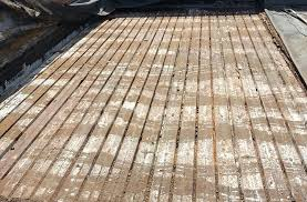 flat roof metal deck replacement commercial