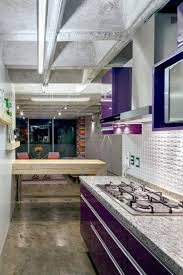 quirky all concrete apartment embraces color in mexico city curbed