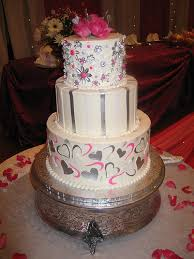 3 tier wicked chocolate wedding cake white butter icing pink