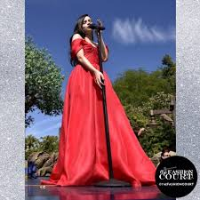 sofia carson wore a red off shoulder gown on the