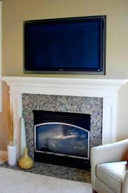 fireplace mantels with tv mounted above mantel ideas photo design