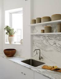how take dwell photo the showstopping material elements are borghini honed marble countertop and backsplash ann sacks