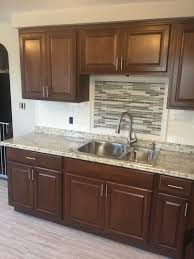kitchen backsplash medallions hampton bay cognac kitchen cabinets with subway tile backsplash