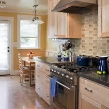 copper tile backsplash kitchen mediterranean with bird gray