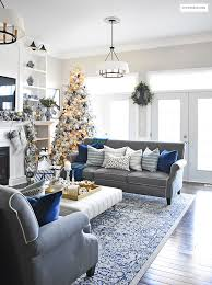 blue livingroom home tour living room with blue white and gold