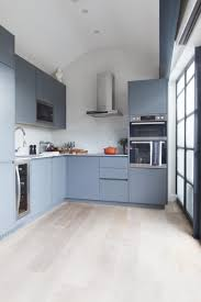 kitchen butlers wharf london deep grey blue cabinetry against white