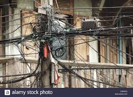 messy electric wires in bangkok thailand stock photo royalty