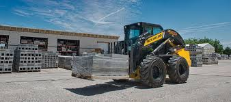 new holland construction introduces its newest most powerful skid
